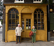 UK - Friday, Aug 01 2008:  Brian and Anne Horrell stand outside the entrance of the Whitechapel Bell Foundry in London. (Photo by Peter Horrell / http://www.peterhorrell.com)