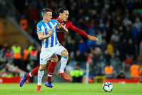 Liverpool's Virgil van Dijk vies for possession with Huddersfield Town's Jonathan Hogg<br /> <br /> Photographer Alex Dodd/CameraSport<br /> <br /> The Premier League - Liverpool v Huddersfield Town - Friday 26th April 2019 - Anfield - Liverpool<br /> <br /> World Copyright © 2019 CameraSport. All rights reserved. 43 Linden Ave. Countesthorpe. Leicester. England. LE8 5PG - Tel: +44 (0) 116 277 4147 - admin@camerasport.com - www.camerasport.com