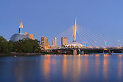 Canadian Museum for Human Rights (CMHR) and the Esplanade Riel Bridge and the Red River at sunrise<br /> Winnipeg<br /> Manitoba<br /> Canada