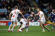 England's Daryl Clark (17 Warrington Wolves) gets the tackle on Adam Walker (8 Hull KR) during the Ladbrokes Four Nations match between England and Scotland at the Ricoh Arena, Coventry, England on 5 November 2016. Photo by Craig Galloway.