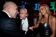 JEAN-PAUL GAULTIER; DR. HERMANN BUELBECKER; ROSANNA DAVIDSON, Grey Goose character and cocktails. The Elton John Aids Foundation Winter Ball. off Nine Elms Lane. London SW8. 30 October 2010. -DO NOT ARCHIVE-© Copyright Photograph by Dafydd Jones. 248 Clapham Rd. London SW9 0PZ. Tel 0207 820 0771. www.dafjones.com.