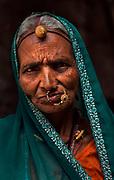 Tribal woman farming near Kumbalgarh Fort, Rajasthan