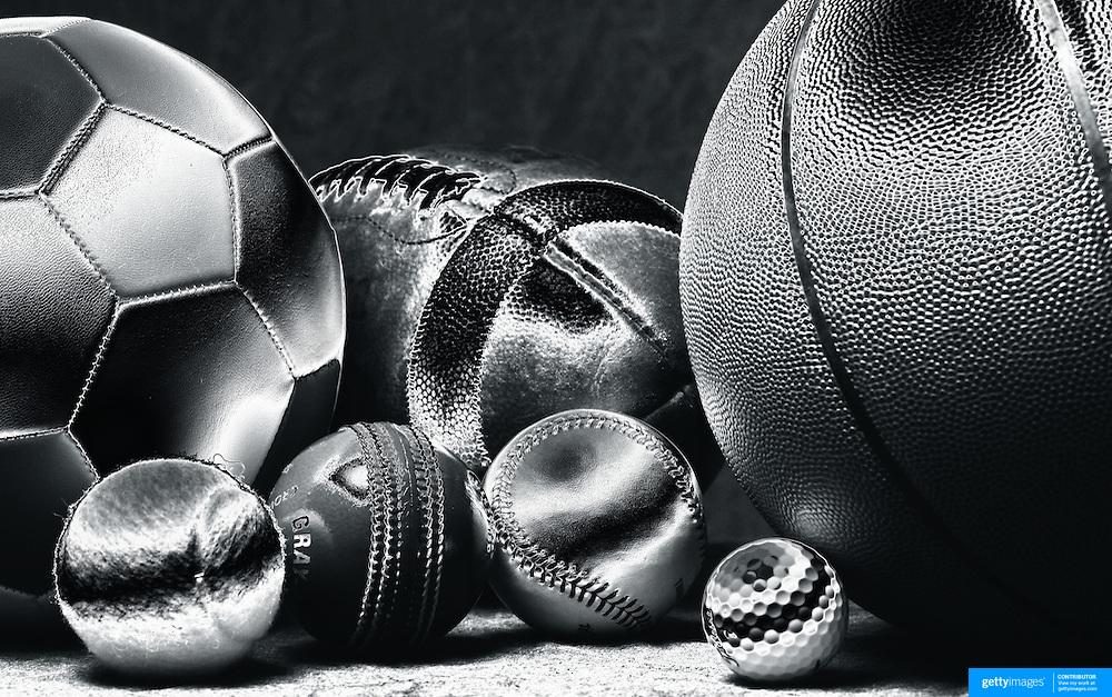 A studio shot of a Baseball, a Basketball an American Football, a soccer ball, a golf ball a tennis ball and a cricket ball. 20th October 2012. Photo Tim Clayton