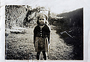 damage photo portrait of a young girl standing in the garden England