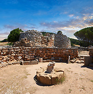 Pictures and image of the exterior ruins of Palmavera prehistoric Nuragic village meeting hall with Nuraghe tower behind,  archaeological site, middle Bronze age (1500 BC), Alghero, Sardinia. .<br /> <br /> If you prefer you can also buy from our ALAMY PHOTO LIBRARY  Collection visit : https://www.alamy.com/portfolio/paul-williams-funkystock/palmavera-nuraghe-sardinia.html<br /> Visit our PREHISTORIC PLACES PHOTO COLLECTIONS for more   photos  to download or buy as prints https://funkystock.photoshelter.com/gallery-collection/Prehistoric-Neolithic-Sites-Art-Artefacts-Pictures-Photos/C0000tfxw63zrUT4