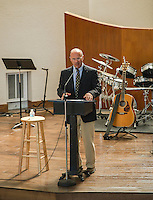 Mark Petrozzi, Elder welcomes parishoners and guests during the Evangelical Baptist Church dedication ceremony on Sunday afternoon.  (Karen Bobotas/for the Laconia Daily Sun)