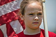 """Young girl at a """"Save America Rally"""" in Baton Rouge on the 4th of July across the street from the Governor's Mansion where about 200 gathered. The 4th of July rally was organized by Jeff Crouer, Mimi Owens and Woody Jenkins, chairman of the executive committee for the Republican Party in East Baton Rouge Parish. Rev. Tony Spell of Life Tabernacle Church who has held church services in defiance of a stay-at-home order throughout the pandemic was one of the speakers. He an other speakers expressed their displeasure of being told to wear a mask to prevent the spread of Covid-19 and the removal of confederate monuments."""