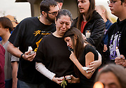 The Fischer family, Derrick, Amanda and Sally, 12, from left, mourn Daniel Kaufman at a public memorial at the Santa Fe Dam Recreational Area in Irwindale. Kaufman was a victim of the mass shooting in San Bernardino, CA.