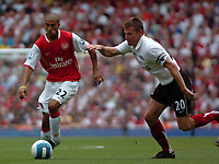 Photo: Tony Oudot. <br /> Arsenal v Fulham. Barclays Premiership. 12/08/2007. <br /> Gael Clichy of Arsenal goes past Brian McBride of Fulham
