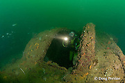 diver explores the wreck of the USS New York ( aka USS Rochester / USS Saratoga ), a 117 m long American armored cruiser. The wreck lies on its port side in 27 m of water with the starboard side at a depth of 18m in the Port of Olongapo, Subic Bay, Philippines. The ship was scuttled Dec. 14, 1941 to prevent capture by the Japanese.<br /> MR 379