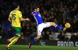 Birmingham City's Lukas Jutkiewicz (right) and Norwich City's Timm Klose battle for the ball