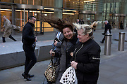 As Storm Doris blows across the UK, pedestrians on Fenchurch Street, brave the high winds funneled through the narrow streets, squeezed between the tall buildings of financial and insurance institutions in the City of London, on 23rd February 2017. Strong winds have led to flight cancellations and road and rail disruption across much of Britain. Thousands of homes have been left without power in Northern Ireland, Wales, Scotland and northern England.
