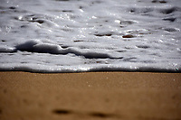 Waves and foam on the beach
