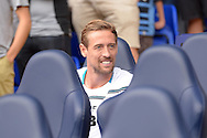 Peter Crouch of Stoke City smiles while sitting in the dugout before k/o. Barclays Premier league match, Tottenham Hotspur v Stoke city at White Hart Lane in London on Saturday 15th August 2015.<br /> pic by John Patrick Fletcher, Andrew Orchard sports photography.