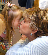 Sub5/10/05 Jane Fonda kiss<br /> ML0188C<br /> Eliza Richard age 2 1/2 of Branford gives actress and author Jane Fonda a kiss during Fonda's booksigning at the Scranton Library, Madison. Richard's mom June brought Eliza to hear Fonda speak. Photo by Mara Lavitt