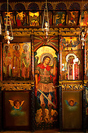 Interior of St Georges  traditional Greek Orthodox church, Chora, Mykonos, Cyclades Islands, Greece. .<br /> <br /> Visit our GREEK HISTORIC PLACES PHOTO COLLECTIONS for more photos to download or buy as wall art prints https://funkystock.photoshelter.com/gallery-collection/Pictures-Images-of-Greece-Photos-of-Greek-Historic-Landmark-Sites/C0000w6e8OkknEb8