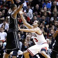 29 January 2012: Chicago Bulls center Joakim Noah (13) defends on Miami Heat power forward Chris Bosh (1) during the Miami Heat 97-93 victory over the Chicago Bulls at the AmericanAirlines Arena, Miami, Florida, USA.