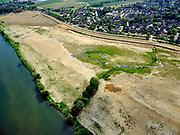 Nederland, Limburg, Gemeente Horst aan de Maas.; 27-05-2020; Hoogwatergeul Ooijen, weerd ten zuiden van Ooijen, gezien naar Broekhuizenvorst. Insnijding in stijlranddijk, uiterwaard (weerd) afgegraven. Werkzaamheden voor de Gebiedsontwikkeling  Ooijen en Wanssum, waaronder aanleg van een  hoogwatergeul. weerdverlaging en natuurontwikkeling.<br /> High water channel Ooijen, floodplain south of Ooijen, style edge dike, flood plain excavated.<br /> <br /> luchtfoto (toeslag op standard tarieven);<br /> aerial photo (additional fee required)<br /> copyright © 2020 foto/photo Siebe Swart