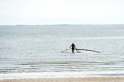 Wind surfer off Cleethorpes beach. Cleethorpes is situated on Englands East Coast on the river Humber's tidal estuary. ..1 July 2012.Image © Paul David Drabble