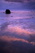 A basalt rock formation on the Oregon Coast at dusk with a rainstorm on the horizon. Cannon Beach, Oregon. 1998.