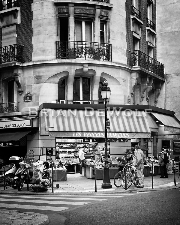 There is a small village feel to this image of a corner store in Paris, France.  Aspect Ratio 1w x 1.25h.
