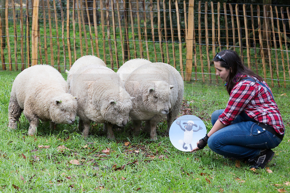"© Licensed to London News Pictures. 26/03/2015. London, England. Pictured: Shepherdess Ellie Burch, 22, from Croydon with a flock of five Southdown ewes from Wakehurst Place.  Kew Gardens' Easter Festival ""Shaun the Sheep"" opens at Kew Gardens on 28 March and runs to 12 April 2015.  Photo credit: Bettina Strenske/LNP"