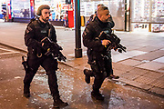 Armed police begin to work their way down oxford street - Armed police flood the Oxford Circus area after an incident caused the station to be cleared.