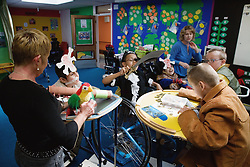 Children with learning and physical disabilities learning about pirates in a lesson,