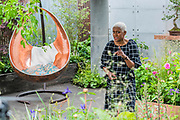 Arit anderson of the BBC in Space to Grow, The Silent Pool Gin Garden - Press preview day at The RHS Chelsea Flower Show.