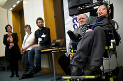 © London News Pictures. 30/04/2013. London, UK. Professor Stephen Hawking (right) speaking at the launch of a report by the charity Breathe On UK at Portcullis House in London on April 30, 2013. Breathe On UK supports families of children on long-term ventilation. Photo credit: Ben Cawthra/LNP.