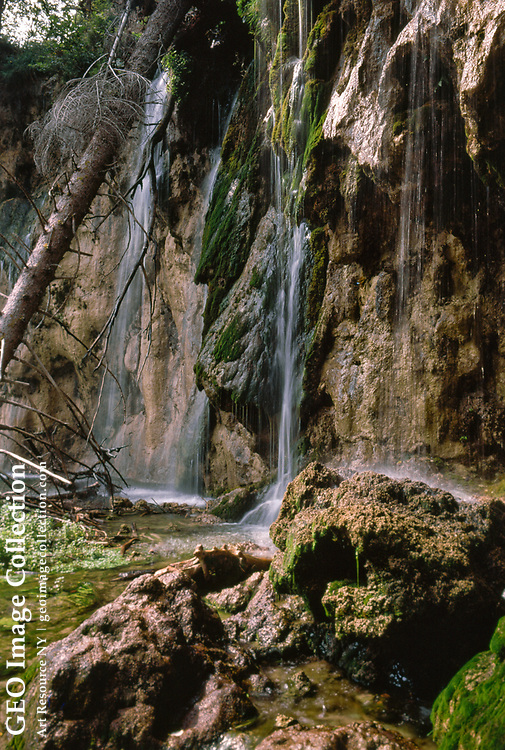 Waterfall at the Plitvice Lakes National Park, Plitvice municipality, in Croatia, Europe. The water source is runoff from the surrounding mountains. It is a major nature tourist attraction and was declared a UNESCO World Heritage Site.