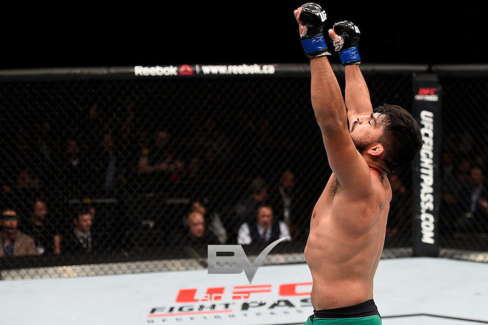 TORONTO, CANADA - DECEMBER 10:  Kelvin Gastelum celebrates after his TKO victory over Tim Kennedy in their middleweight bout during the UFC 206 event inside the Air Canada Centre on December 10, 2016 in Toronto, Ontario, Canada. (Photo by Jeff Bottari/Zuffa LLC/Zuffa LLC via Getty Images)