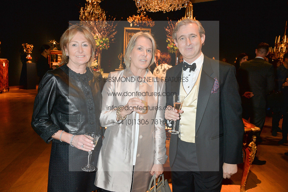 Left to right, LORRAINE SPENCER, PENNY BAINES and TIM GOSLING at a party to celebrate the publication of Interiors For Living by Joanna Wood held at Christie's. 8 King Street, St.James's, London on 2nd March 2015.