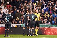 Referee show second yellow card to Real Sociedad's Iñigo Martinez during La Liga match between Real Madrid and Real Sociedad at Santiago Bernabeu Stadium in Madrid, Spain. January 29, 2017. (ALTERPHOTOS/BorjaB.Hojas)