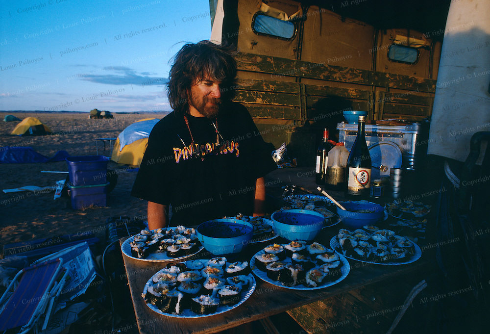 Mark Norell in Ukaa Tolgod in the Gobi Desert. Looking over dinner after a day of excavating.