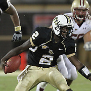 Central Florida quarterback Jeff Godfrey (2) runs the ball during an NCAA football game between the Boston College Eagles and the UCF Knights at Bright House Networks Stadium on Saturday, September 10, 2011 in Orlando, Florida. (AP Photo/Alex Menendez)