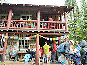 Crowds gather to warm during the rain at the Plain of the Six Glaciers Teahouse, near Lake Louise; Banff National Park, Alberta, Canada