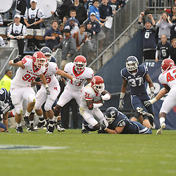 Oct 31, 2009; East Hartford, CT, USA; Rutgers cornerback Devin Mccourty (21) returns a kickoff during the closing 38 seconds of  second half Big East NCAA football action in Rutgers' 28-24 victory over Connecticut at Rentschler Field.