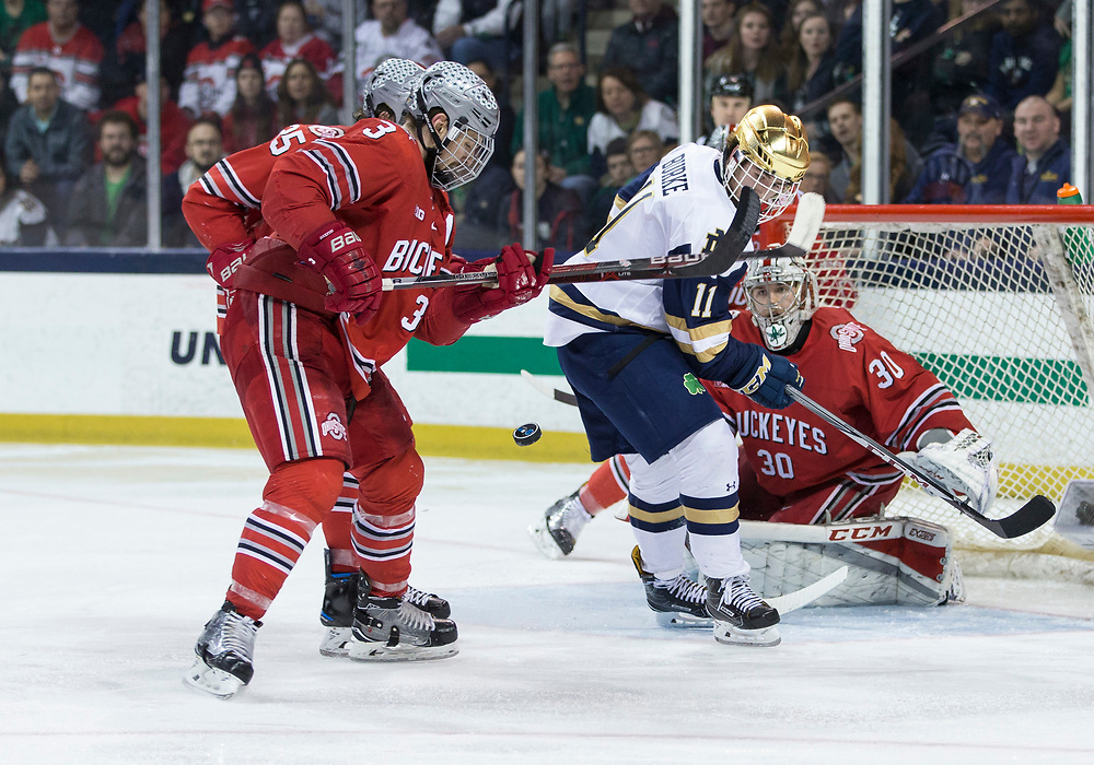 March 17, 2018:  Ohio State goaltender Sean Romeo (30) makes the save on shot by Notre Dame forward Cal Burke (11) during NCAA Hockey game action between the Notre Dame Fighting Irish and the Ohio State Buckeyes at Compton Family Ice Arena in South Bend, Indiana.  Notre Dame defeated Ohio State 3-2 in overtime.  John Mersits/CSM