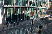 Modern glass offices at Moorgate in the City of London, England, United Kingdom. As Londons financial district grows in height, the architecture has changed the face of Londons financial district, with many different companies occupying the various floors and levels.