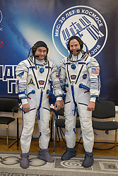 At the Baikonur Cosmodrome in Kazakhstan, Expedition 57 crewmembers Alexey Ovchinin of Roscosmos (left) and Nick Hague of NASA (right) pose for pictures in their Russian Sokol launch and entry suits Sept. 26 as part of pre-launch training activities. They will launch Oct. 11 in the Soyuz MS-10 spacecraft from the Baikonur Cosmodrome for a six-month mission on the International Space Station.<br /> <br /> NASA/Victor Zelentsov