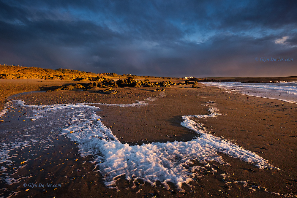 Intense and brilliant low afternoon winter sunlight near Rhosneigr. The strong winds whipped up surf foam which then blew inland, creating some incredible geometricals along the way. I couldn't understand how such a striking right angle could be formed from such fluidly moving foam!