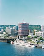 "Ackroyd C04574-4. ""Benjamin Franklin Savings & Loan. Aerials with Navy ships. June 11, 1978"" (Navy ships on Waterfront Park for Rose Festival. Benjamin Franklin Plaza is now called Umpqua Bank Plaza)"