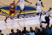 Golden State Warriors and Cleveland Cavaliers players run down the court at Oracle Arena in Oakland, Calif., on January 16, 2017. (Stan Olszewski/Special to S.F. Examiner)