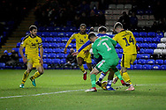 Oxford United's goalkeeper Simon Eastwood (1) clears the ball in the goalmouth scramble during the EFL Sky Bet League 1 match between Peterborough United and Oxford United at London Road, Peterborough, England on 8 December 2018.