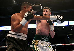 Tyrone McCullagh (right) against Elvis Guillen during their International Featherweight bout at the SSE Arena, Belfast.