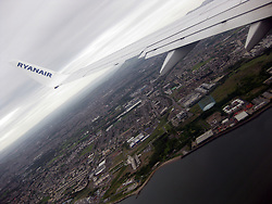 Photographs onboard an early morning Ryanair flight on it's approach over the Firth of Forth, near Leith, Edinburgh, on the way to land at Edinburgh airport, a day after the latest Iceland volcano dust scare.