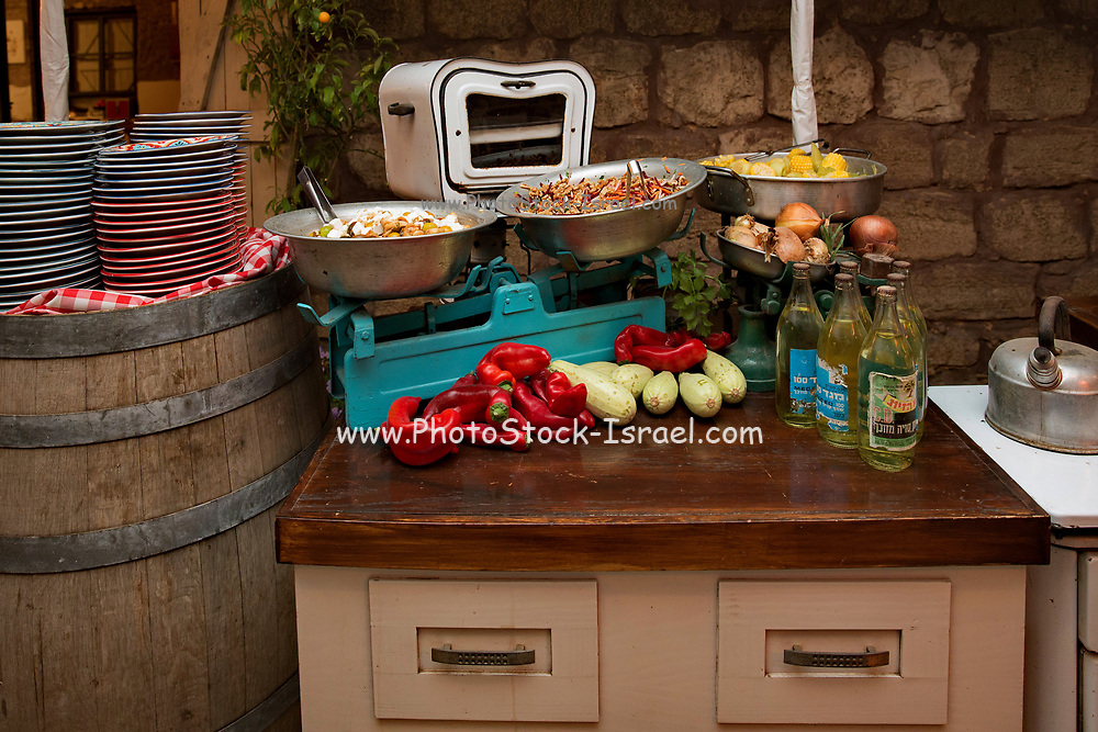 Rustic style buffet table laid out with an assortment of food at an evening event