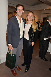 LUKE RODGERS and his wife PHOEBE DICKINSON at a reception to celebrate the publication of Hockney - A Pilgrim's Progress by Christopher Simon Sykes held at Sotheby's, New Bond Street, London on 30th September 2014.