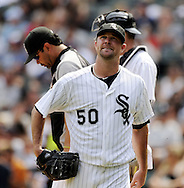CHICAGO - JULY 27:  John Danks #50 is removed from the game by manager Ozzie Guillen #13 of the Chicago White Sox during the seventh inning against the Detroit Tigers on July 27, 2011 at U.S. Cellular Field in Chicago, Illinois.  The White Sox defeated the Tigers 2-1.  (Photo by Ron Vesely)  Subject: John Danks;Ozzie Guillen